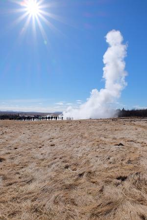 Strokkur Geyser eruption under the sun.
