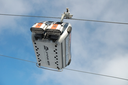 Janske Lazne, Czech Republic - February 17, 2015: Cable car on gondola lift on Cerna Hora mountain in Karkonosze mountains nearby Janske Lazne in Czech Republic.