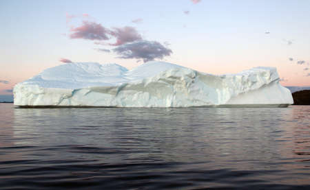 Stunning iceberg on a beautiful summer evening