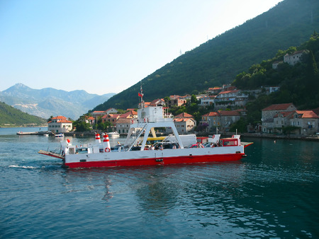 small, old, white and red ferryboat in Montenegro