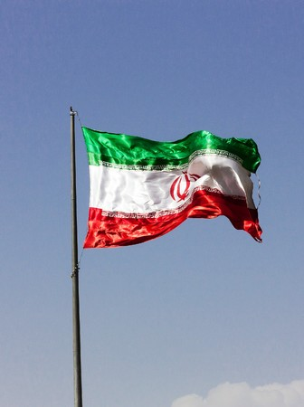 Iranian flag on mast blowing in the wind