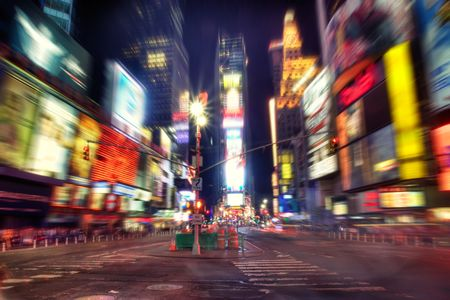 Times Square, New York at night. Radial blur