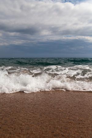 Splashing wave at Mediterranean sea coast.