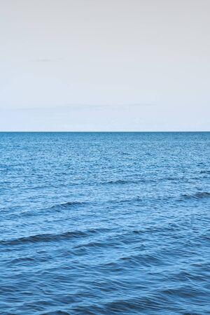 Foto de Still summer day by gulf of Riga, Baltic sea. - Imagen libre de derechos