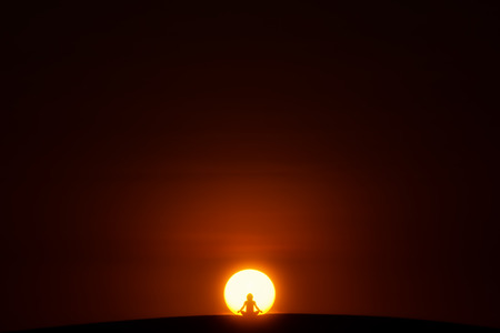Meditation. A person is sitting in the Lotus pose in center of the Sun.