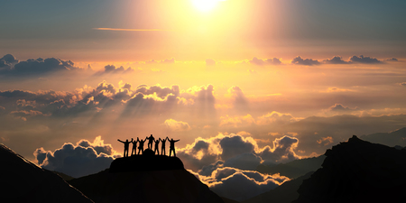 Photo pour On the top of the world together. A group of people stands on a hill over the beautiful cloudscape. - image libre de droit