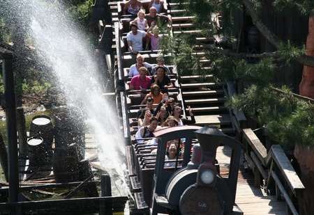 People in the Big Thunder mountain railroad in Euro Disneyland Park in Paris, France