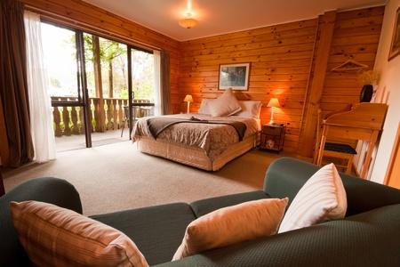 Nice warm interior of mountain wooden lodge bedroom. Fox Glacier Lodge, Fox Glacier, West Coast, South Island, New Zealand.