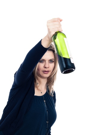 Drunk woman holding bottle of wine, isolated on white background.