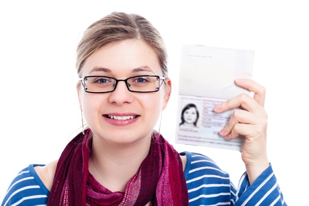 Happy tourist traveller woman showing passport, isolated on white background.