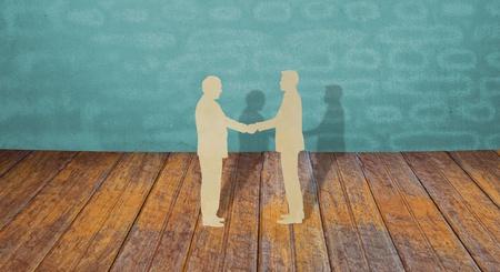 Photo pour Paper cut of two business man shake hand - image libre de droit