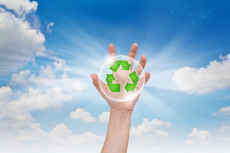 Eco concept : Business hand point recycling symbol
