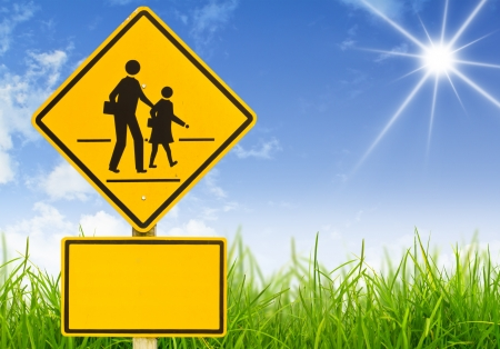 Traffic sign (School warning sign) on grass