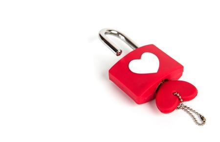 Photo pour Heart padlock and key on a white background - image libre de droit