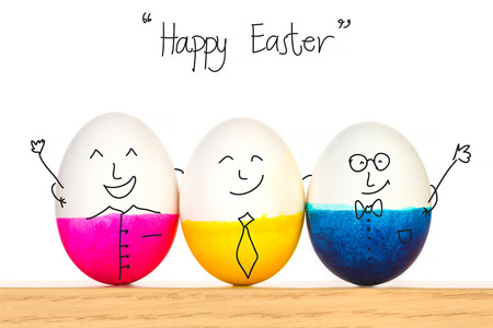 Photo for Happy Easter eggs on wooden table - Royalty Free Image