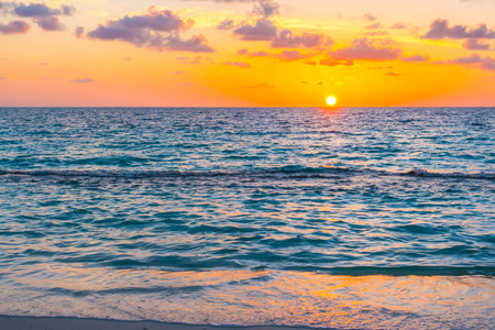 Photo for Beautiful sunset with sky over calm sea  in tropical Maldives island - Royalty Free Image