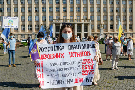 Uzhgorod, western Ukraine - June 30, 2020: Union workers in protective masks are protesting against antiprofessional bill number 2681 during quarantine.