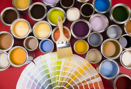 Photo pour Collection of colored paints cans, Brush, red background - image libre de droit