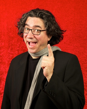 Longhaired french intellectual man, middle-aged, red back ground lifting his finger joyfully
