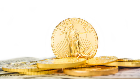 one ounce of golden eagle standing on edge on other golden coins