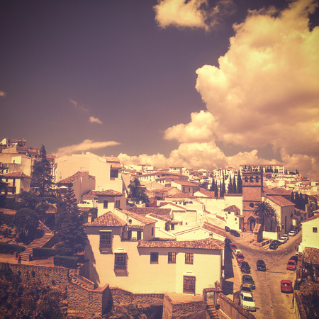 view of Ronda, Andalusia, Spain in vintage retro style with their typical architectue on hot summer day without people