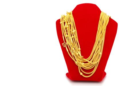 Photo pour Gold necklaces on necklace display stand white background. - image libre de droit