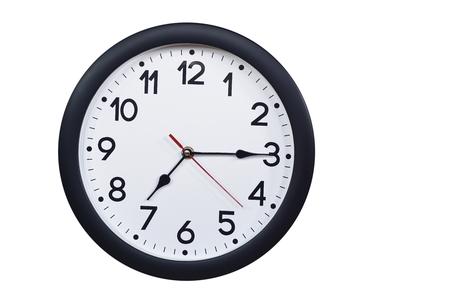 Foto de Time concept with black clock at a quarter past seven - Imagen libre de derechos