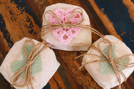 Brazilian wedding sweet bem casado with crochet and paper heart on wooden table