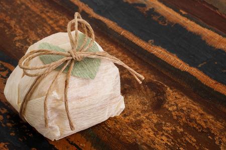Brazilian wedding sweet bem casado with green paper heart on wooden table