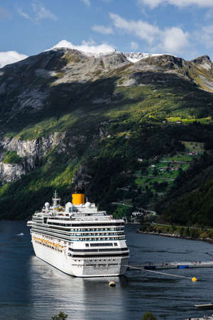 Photo pour Editorial 09.07.2019 Geiranger Norway Costa Pacifica in port at Geiranger in the big fjord on a sunny summer day - image libre de droit