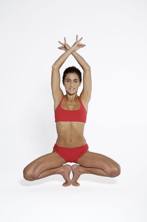 Young woman practicing yoga, studio shot