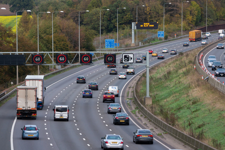 Photo for London, UK - October 18, 2018: Evening heavy traffic on busiest British motorway M25 - Royalty Free Image