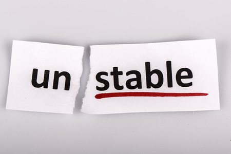 The word stable changed to unstable on torn paper and white background