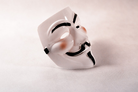 white anonymous mask on white background
