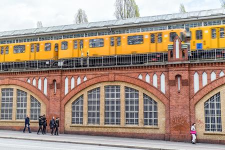 BERLIN, GERMANY - APRIL 8: Yellow train on Oberbaum bridge on April 8, 2017 in Berlin