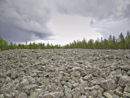 Big stone field under dark sky. Natural background.