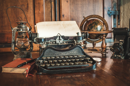 Photo for vintage photography still life with typewriter, folding camera, globe map and book on a wood table. - Royalty Free Image
