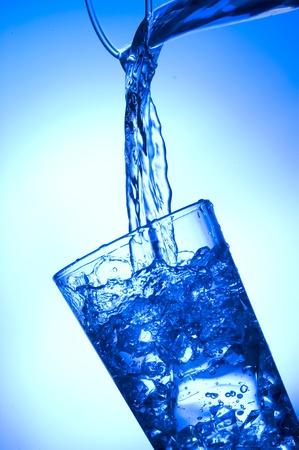 Fresh  spray water on blue background