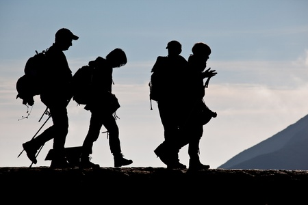 Silhouette of hihing group in mountains