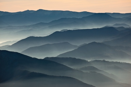 Hazy mountains ranges at dusk