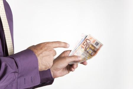 a man paying his debts with euro banknotes