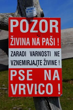 Sign: Pozor zivina na pasi !. Pse na vrvici! - Beware of grazing animals! Dogs on the string!