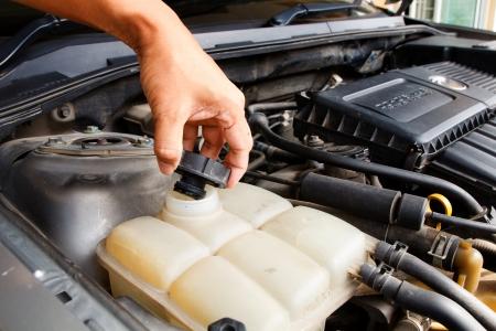 Hand man checking radiator car