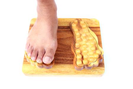Foot massage on a wooden slatted base