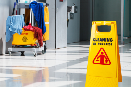 Foto de Janitorial and mop bucket on cleaning in process - Imagen libre de derechos