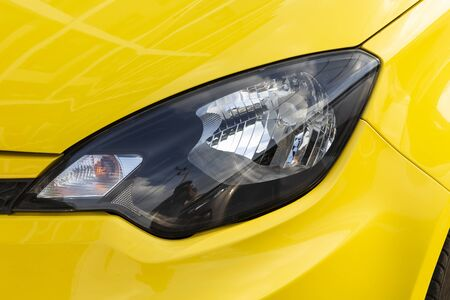 Photo for Yellow car headlights closeup photos - Royalty Free Image