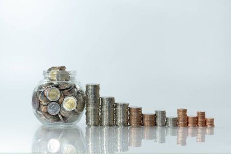 Photo pour Stack of coin on white  table and blur background, selective focus - image libre de droit