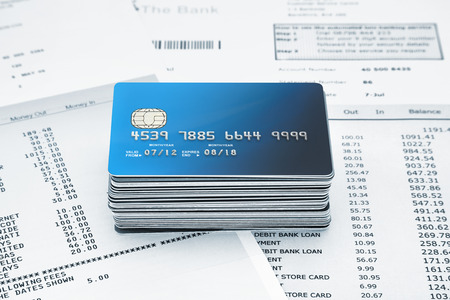 stack of Credit Cards on Bank Statements