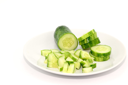 Sliced and diced cucumbers on a white plate