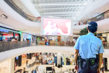 Photo pour Security guard in shopping mall - image libre de droit